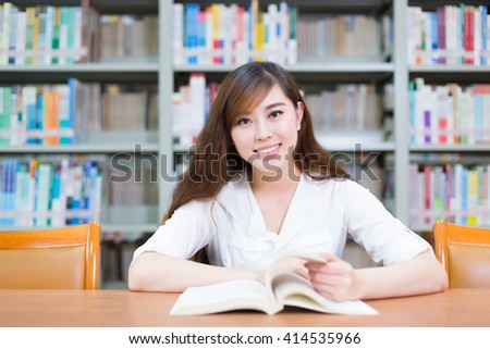 young beautiful asian girl in school library