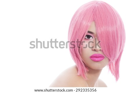 Young beautiful asian girl with stylish pink bob haircut over white background - stock photo