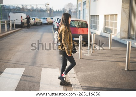 young beautiful asian hipster woman in the city - walking the street crosswalk having fun - stock photo