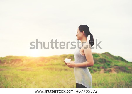 young beautiful asian woman enjoy life and coffee at meadows in the morning.