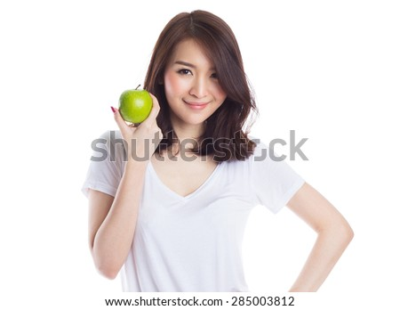 Young beautiful asian woman holding a green apple on white background - stock photo