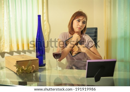 Young beautiful asian woman in depression, drinking alcohol - stock photo