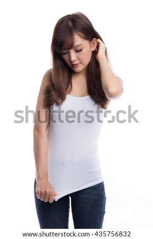 Young beautiful asian woman pointing at her white t-shirt, design concept, blank white t-shirt concepts, isolated on white background - stock photo