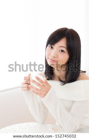 young beautiful asian woman relaxing in the cafe - stock photo