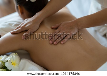 Young beautiful Asian woman relaxing in the spa massage