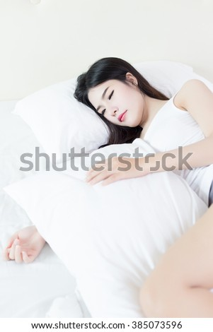 young beautiful asian woman sleeping on bed