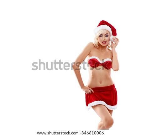 Young, beautiful, attractive, sexy girl, blonde in red suit Snow Maiden in Santa Claus hat, hand on waist, looking into the camera, smiling isolated on white background, portrait.
