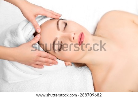 Young beautiful  attractive woman receiving facial massage and spa treatment. Perfect Skin. Skincare. Young Skin - stock photo