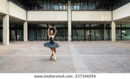 Young beautiful ballerina dancing in Bologna, Italy. Ballerina Project.  - stock photo