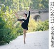 Young beautiful ballerina dancing in Tevere riverside in Rome, Italy. Ballerina Project. - stock photo