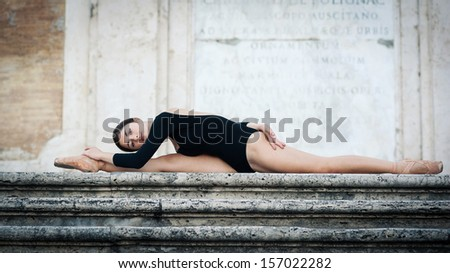 Young beautiful ballerina dancing on the Spanish Steps in Rome, Italy. Ballerina Project.