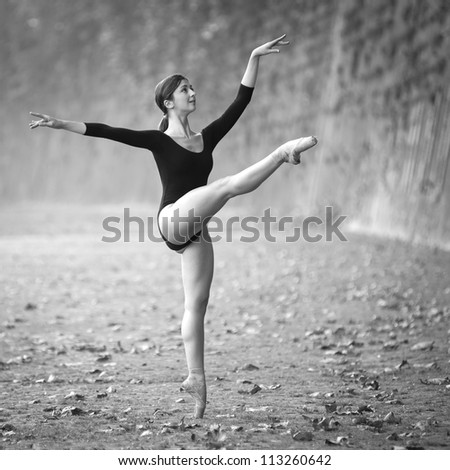 Young beautiful ballerina dancing out in Tevere riverside in Rome, Italy. Black and white image. Ballerina Project. - stock photo