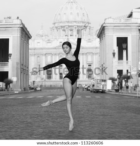 Young beautiful ballerina dancing out in the street in front of St. Peter's Basilica, Rome, Italy. Black and white image. Ballerina Project. - stock photo