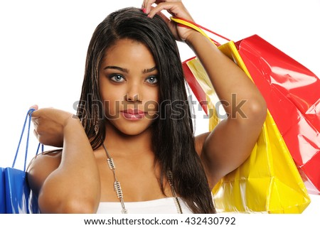 Young beautiful black woman with shopping bags isolated on a white background