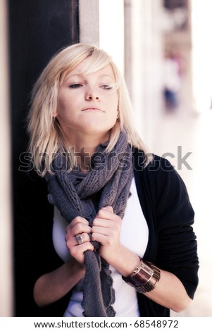 Young beautiful blond girl in sensual posing - stock photo