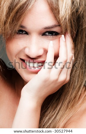 young beautiful blond smiling girl - stock photo