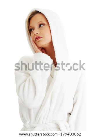 Young beautiful blond teen woman in bathrobe, isolated on white - stock photo