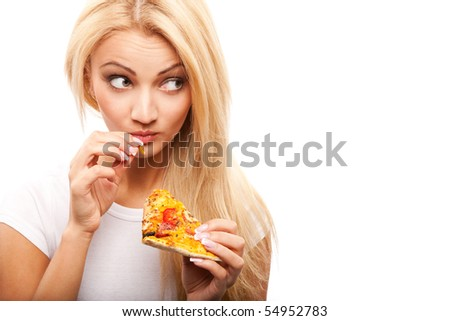 young beautiful blond woman eatting piece of pizza