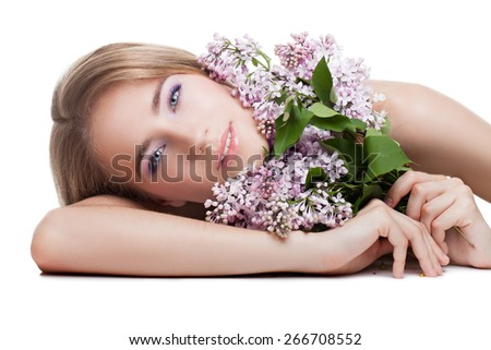 Young beautiful blond woman holding lilac