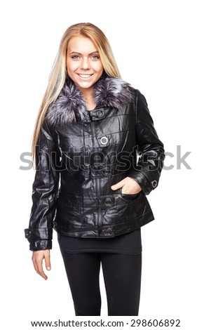 Young beautiful blond woman in a short black jacket with a fur collar - stock photo