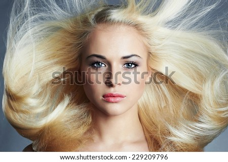 young beautiful blond woman with long hair.pretty girl. Beauty salon haircare - stock photo