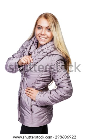 """Young beautiful blonde girl in a pale purple jacket with a collar, made in the style of """"braid""""  - stock photo"""