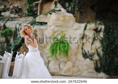 Young beautiful blonde model bride - stock photo