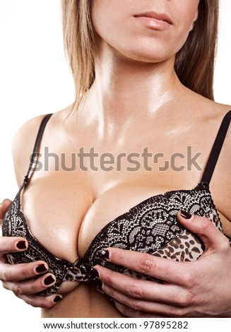 young beautiful blonde woman holding her big  sexy wet breast - stock photo