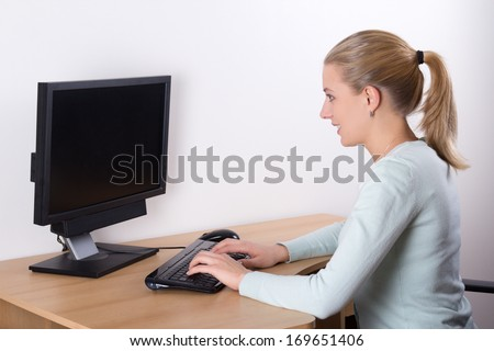 young beautiful blondie woman using pc in living room