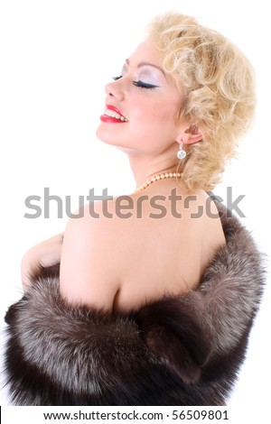 Young beautiful blondie woman with fur collar dreaming. Marilyn Monroe imitation - stock photo
