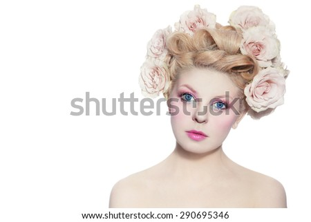 Young beautiful blue-eyed girl with fancy hairdo and make-up over white background - stock photo