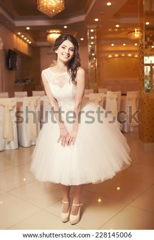 Young beautiful bride in restaurant.  - stock photo