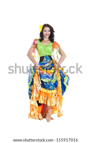 Young beautiful brunette dancing gypsy dance