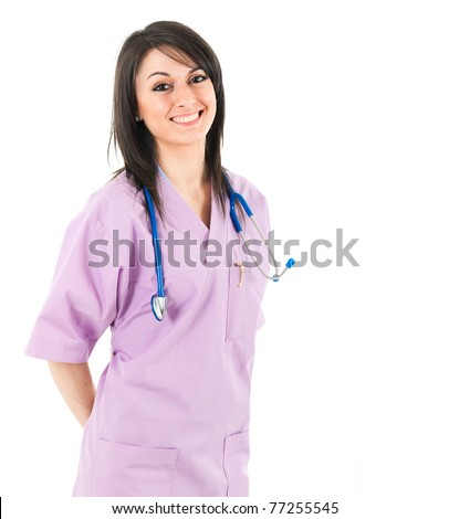 Young beautiful brunette nurse smiling - stock photo