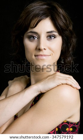 young beautiful brunette portrait against black background - stock photo