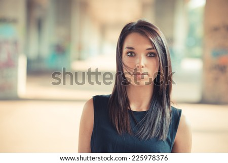 young beautiful brunette straight hair woman outdoor - stock photo
