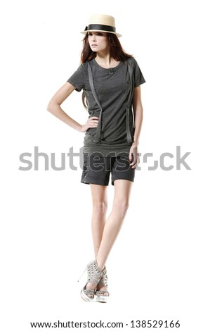 Young beautiful brunette stylish woman in hat -full length - stock photo