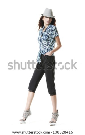 Young beautiful brunette stylish woman isolated full length retro style - stock photo