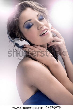 Young beautiful brunette wearing headphones - stock photo