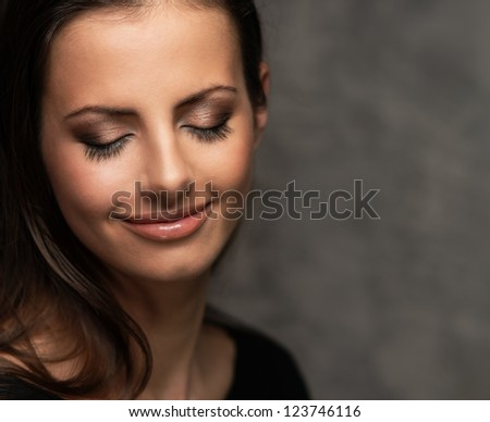 Young beautiful brunette woman dreaming - stock photo