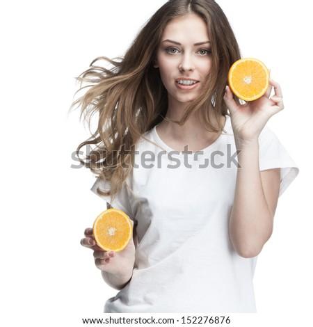young beautiful brunette woman holding orange - stock photo