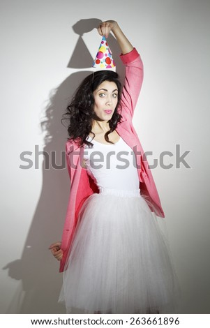Young beautiful brunette woman in bright clothes celebrates her birthday  - stock photo