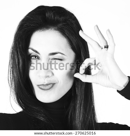 Young beautiful brunette woman showing hand ok sign - stock photo