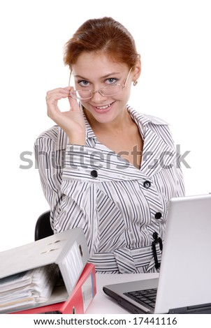 Young beautiful business lady at a table with laptop.