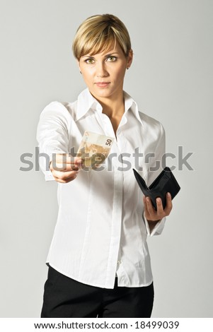 Young beautiful business lady giving a 50 Euro banknote.
