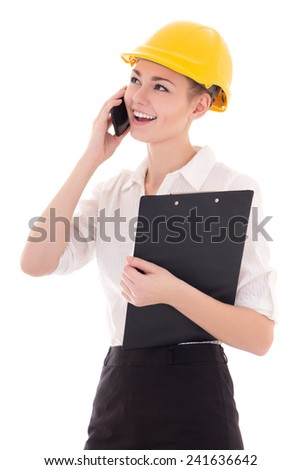 young beautiful business woman architect in builder helmet talking by phone isolated on white background