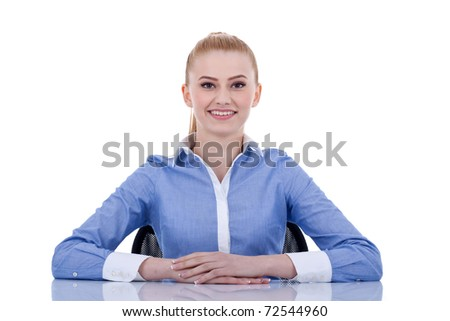 Young beautiful business woman behind the desk, isolated - stock photo