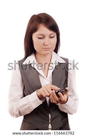 Young beautiful business woman dials a mobile phone on a white background - stock photo