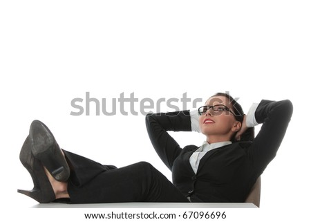 Young beautiful business woman having a rest at the working place. - stock photo