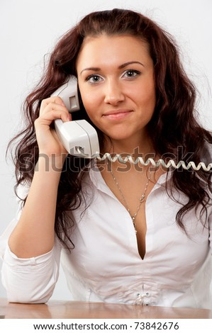 Young beautiful business woman talking phone